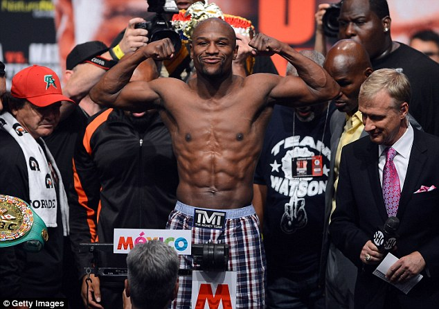 No bother: Mayweather came in under the limit as he looks to defend his unbeaten record against Alvarez