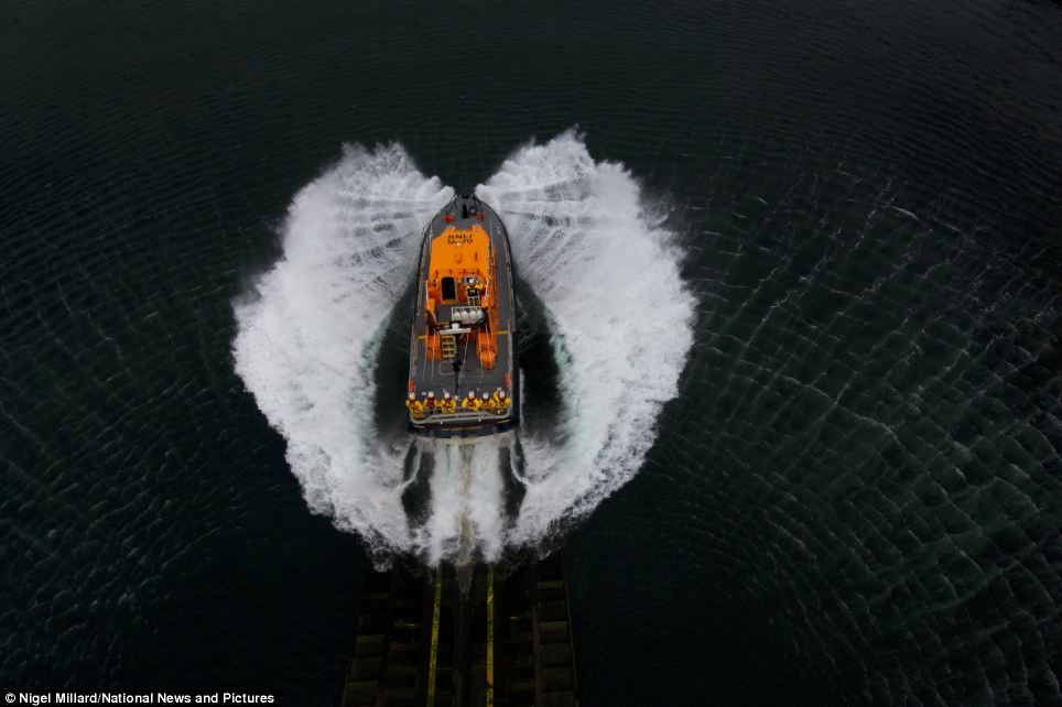 The Lizard's all-weather 'Tamar class' lifeboat, Rose, launches off the slipway
