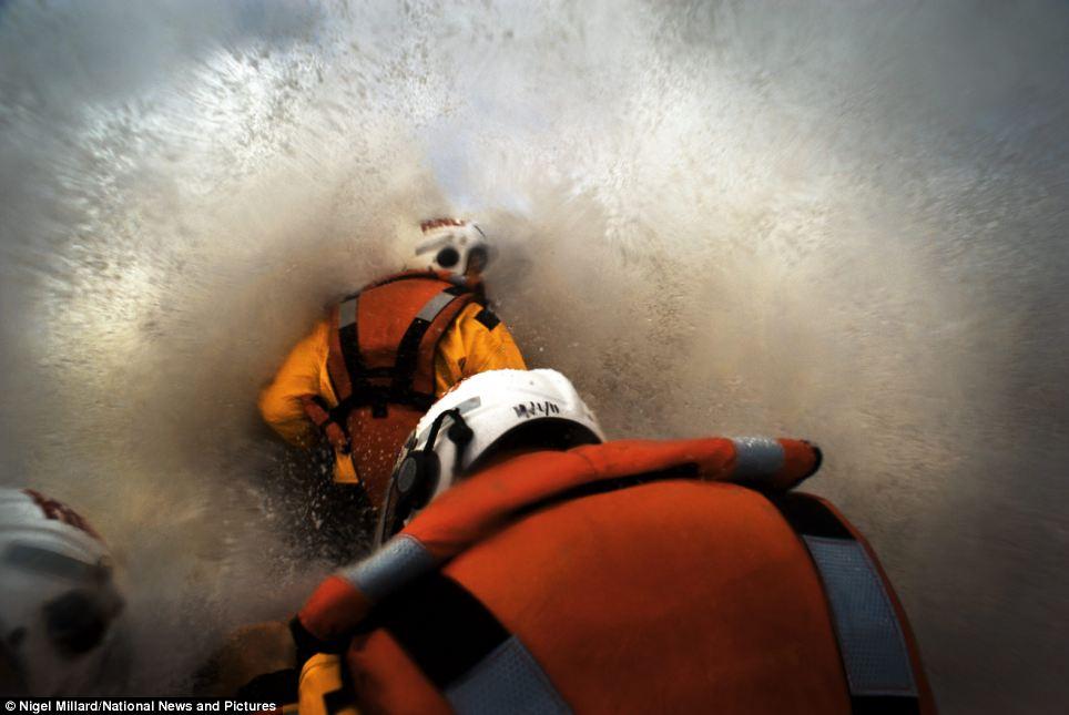 Battling the British seas: Volunteers for the Royal National Lifeboat Institution (RNLI) have been captured working around the clock in bone-chilling conditions for a new book