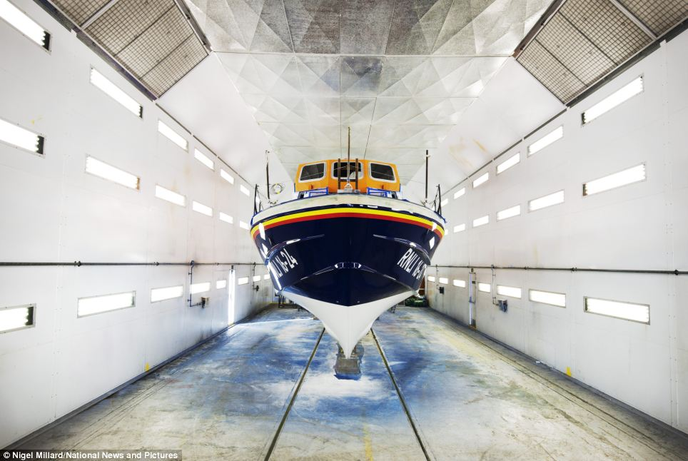 Porthdinllaen's new all-weather 'Tamar class' lifeboat, John D Spicer, gets its first coat of paint in RNLI colours. In the early years of the RNLI lifeboat hulls were painted in pale blue, later changed to the dark Royal Blue seen on today's lifeboats