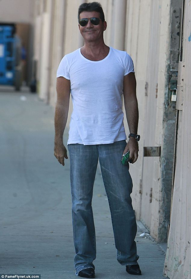 Happy: Simon Cowell pictured earlier this month arriving on the set of The X Factor in Los Angeles