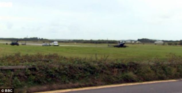 The crash, which incredibly left both instructor and pupil unscathed, happened at Mona airfield in mid-Anglesey (pictured) at 10.50am yesterday