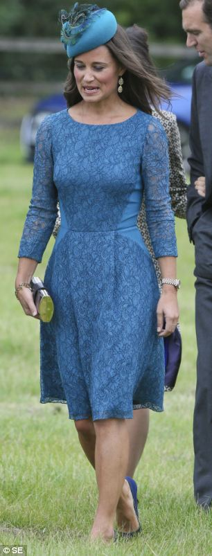 Where's Nico? Pippa looked in high spirits as she walked through the grass and chatted to guests - but her boyfriend was nowhere to be seen