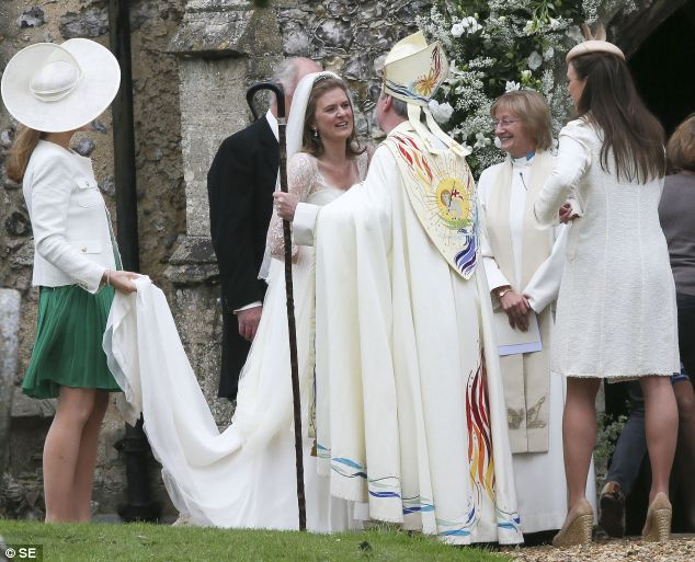 The bride walked from the neighbouring country home of her father, Julian Marsham,who is the the 8th Earl of Romney