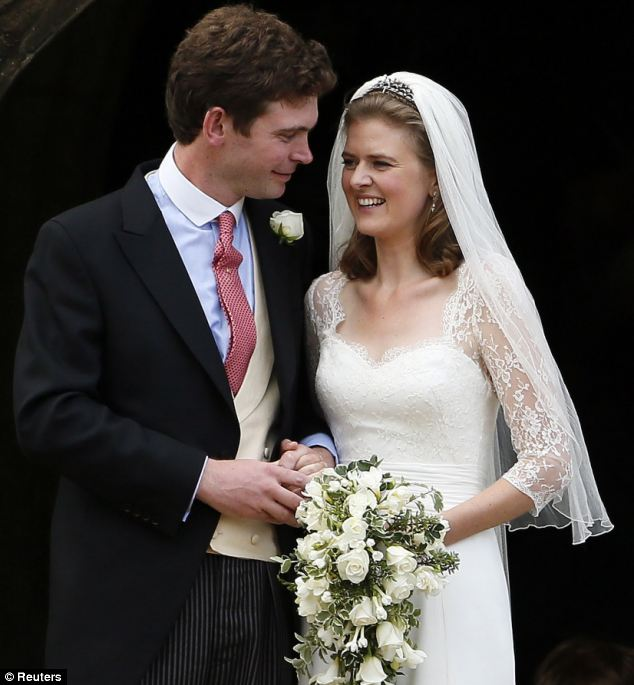 All smiles! The couple looked overjoyed after tying the knot in the beautifully decorated church, whose entrance was elaborately covered in cream flowers