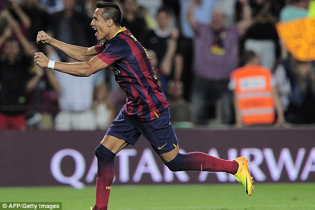 Crucial: Alexis Sanchez celebrates scoring the winning goal in a five-goal thriller against Sevilla