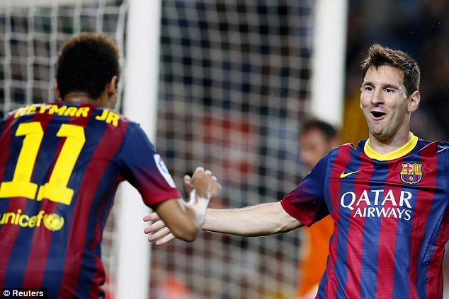 Stars: Lionel Messi rushes to congratulate Neymar after his assist gave him a simple goal