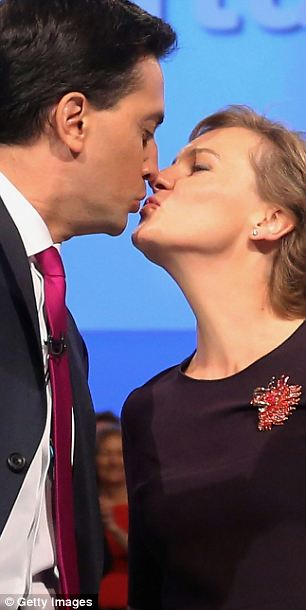 Stick to the day job: Justine Thornton, a successful barrister, puckers up with her husband Ed Miliband at last year's Labour conference