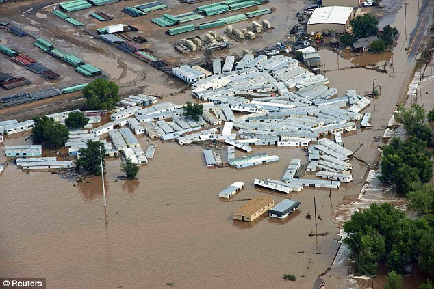 An aerial view of mobile homes submerged in flood waters along the South Platte River near Greenley, Colorado September 14, 2013