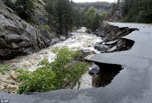 Collapsed: Lefthand Canyon Road near the intersection of Olde Stage Road in Boulder, Colo., on Saturday, Sept. 14, in Boulder. Rescuers rushed by land and by air Saturday to evacuate Coloradoans stranded by epic mountain flooding
