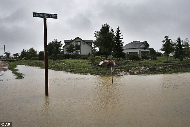 Crossroads: As heavy rains return after somewhat abating for two days, a field fills with water from overflowing creeks nearby, outside Longmont, Colorado on Sunday Sept. 15, 2013