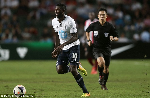 Big bucks: Emmanuel Adebayor is training with the youngsters but picking up a pretty pay packet
