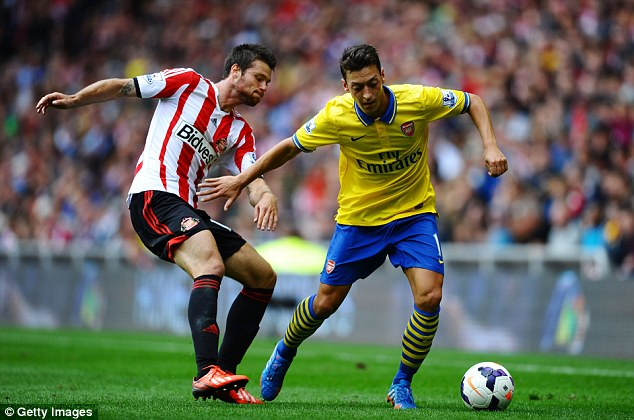 Silky: Ozil dazzled on his debut for Arsenal... but he could have been playing for City or United