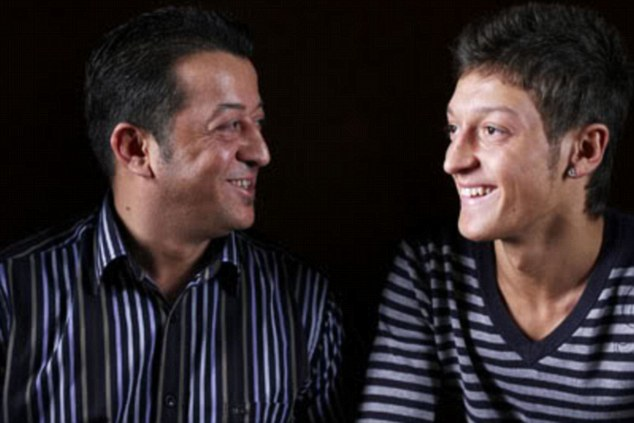 Key player: Mesut Ozil's career has been heavily influenced by his father Mustafa (left)