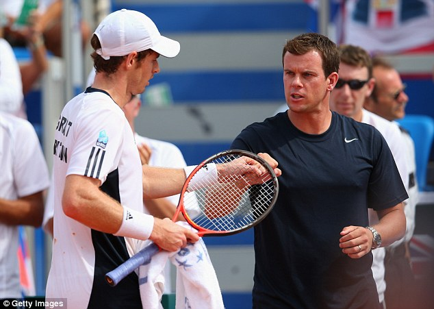Fist-bump: Murray is congratulated by Great Britain captain Leon Smith
