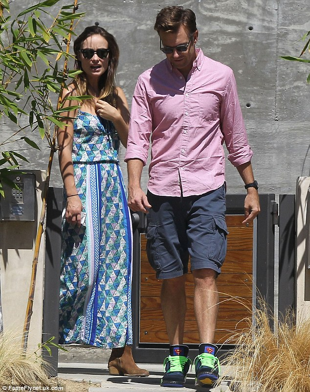 Lots to discuss: The couple were deep in conversation as they left the property