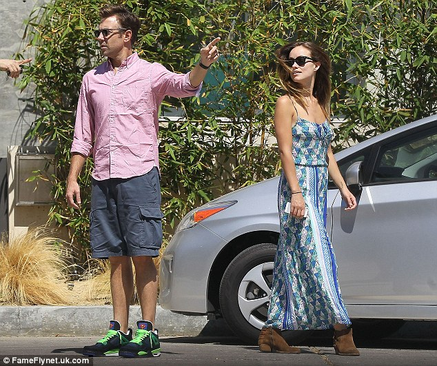 On to the next one: The couple were spotted getting directions to view the next house