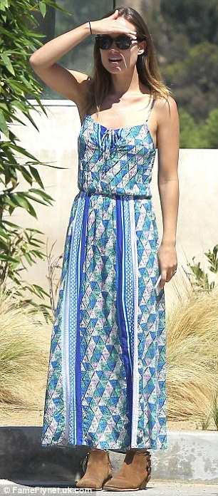 Maximizing her day: Olivia looked beautiful in a blue and green print maxi dress for the trip