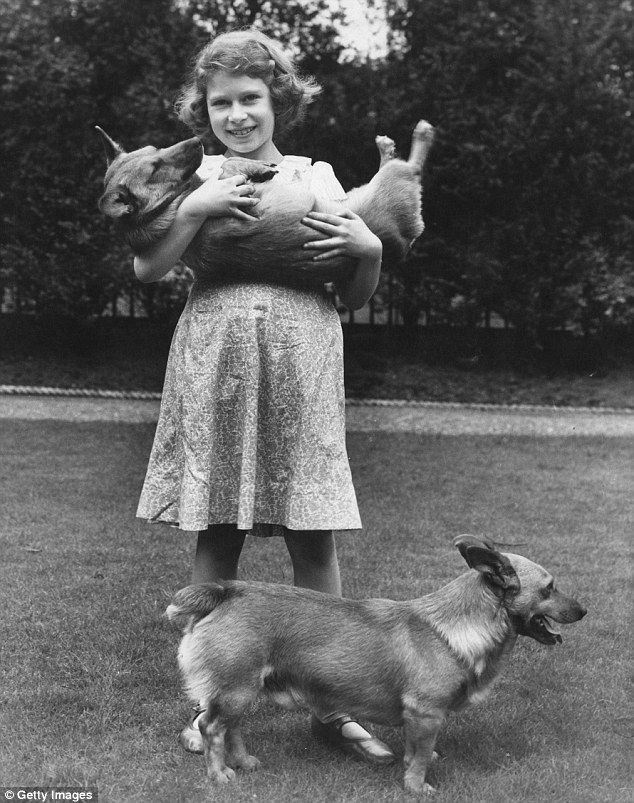 The young Princess with two corgi dogs at her home in July 1936