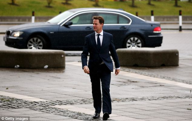 Gloomy: Nick Clegg braved the cold as he walked to the BBC studios in Glasgow this morning