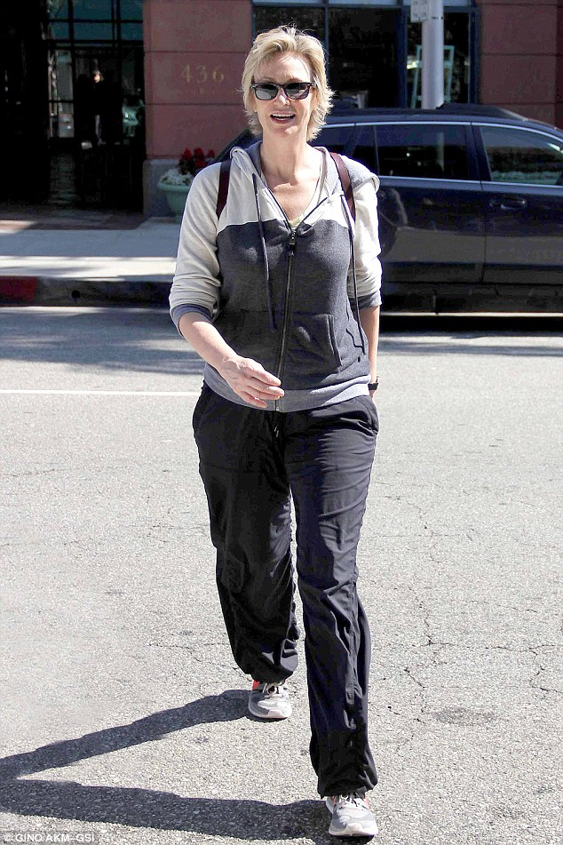 Glee-ful: Jane Lynch indicated she's doing just fine despite her costly divorce from wife Dr Lara Embry during a stroll in Beverly Hills on Thursday