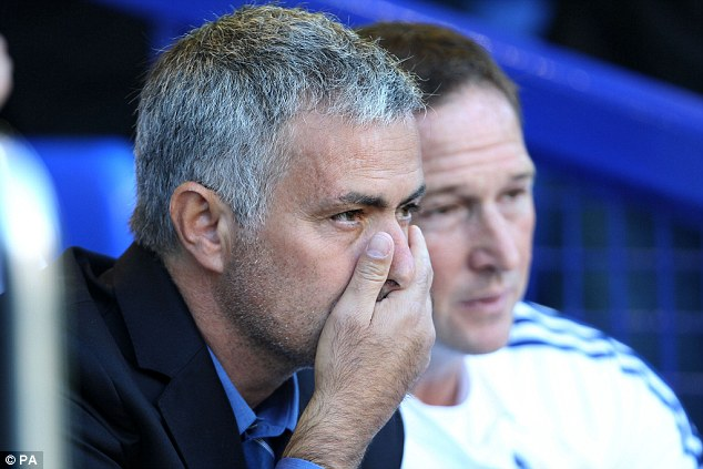We are not unbeatable: Roberto Martinez (above, left) outfoxed Mourinho