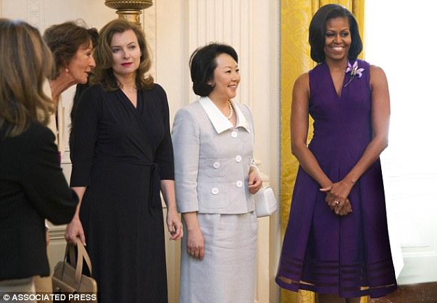 On duty: Trierweiler attending a White House summit with Michelle Obama and Japan's Hitomi Noda