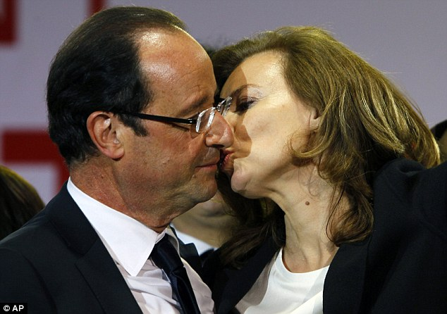 Grand amour: Trierweiler shares a tender moment with François Hollande after the latter's 2012 election victory