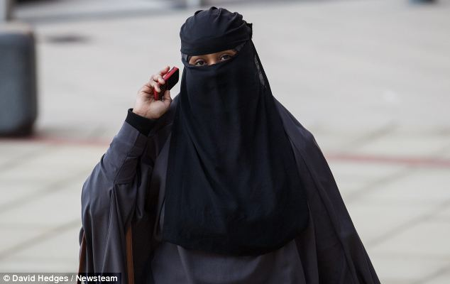 A student at Birmingham Metropolitan College wears a full veil after the college reversed its position which previously banned students from wearing niquabs so they could be 'easily identifiable at all times'