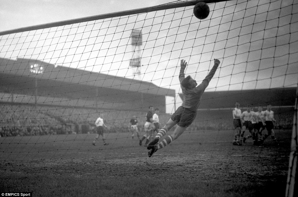 Preston North End goalkeeper Fred Else fails to stop a Tottenham Hotspur free kick from going in
