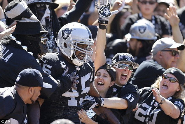 Score: Oakland Raiders fullback Marcel Reece celebrates with fans after an 11-yard touchdown run