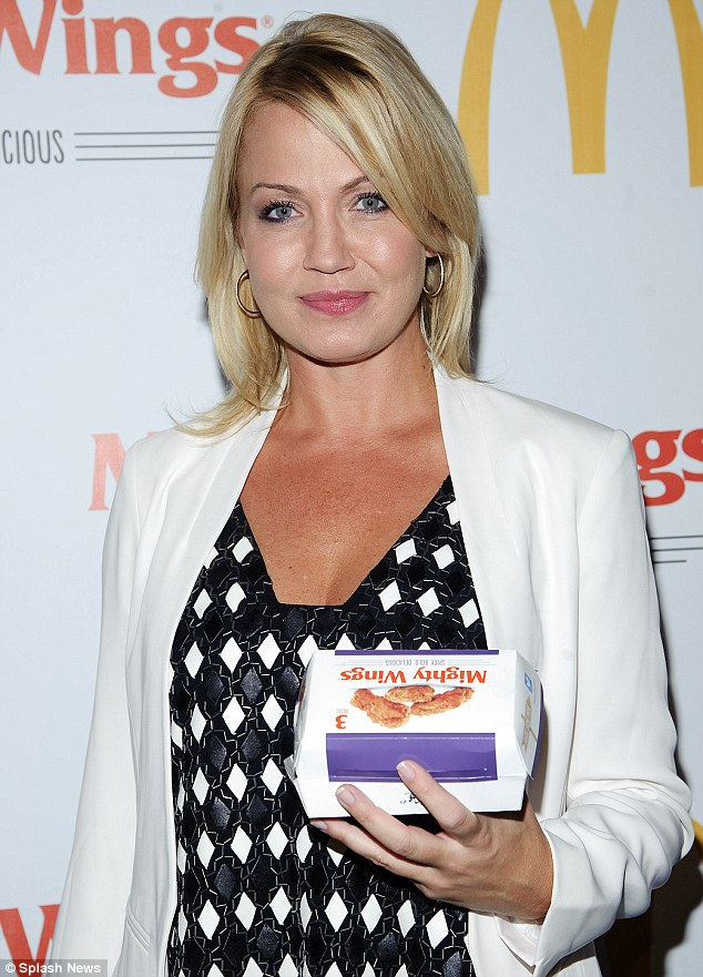 Just holding it: Michelle Beadle posed with a box of the greasy food