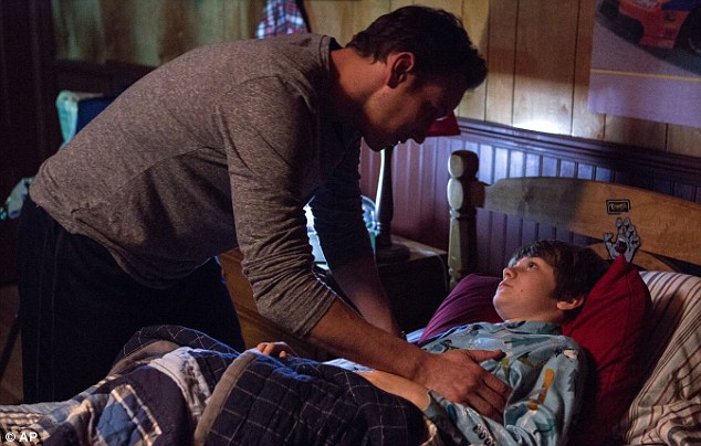 Patrick Wilson, left, and Ty Simpkins in a scene from 'Insidious: Chapter 2.' It led the weekend box office with $41m