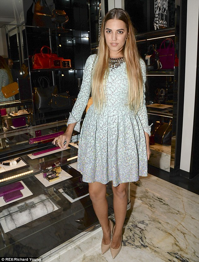 Style queen: Amber Le Bon leads the glamour at Tom Ford's flagship store launch in London on Sunday evening in a mint green longsleeved frock