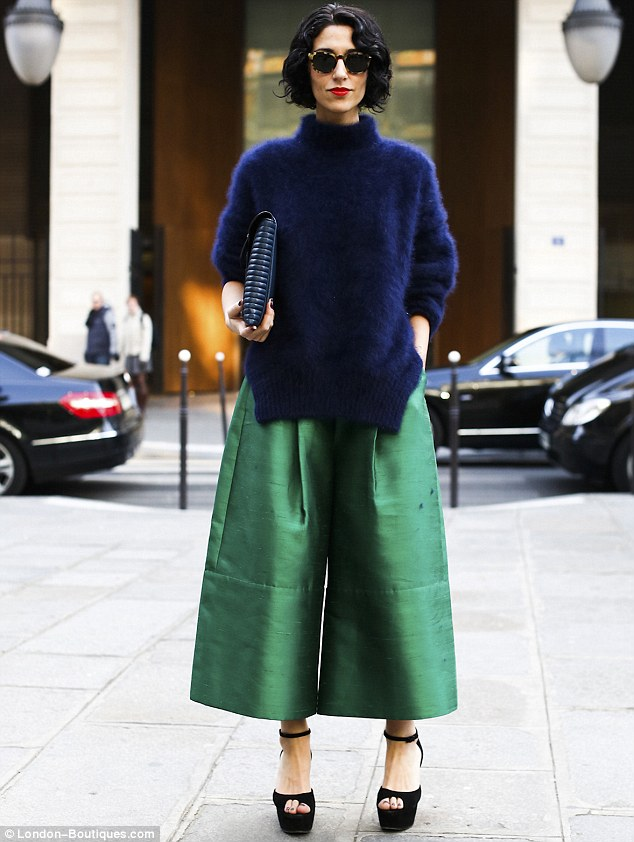 A fuzzy ink jumper, oversized clutch and tough, satin culottes paired with wedges are only for the brave