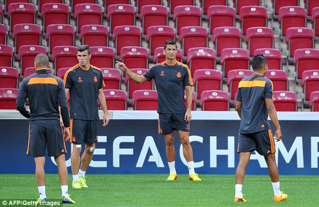 Who's this guy? Gareth Bale (left) and Cristiano Ronaldo (right) train at the TT Arena Stadium in Istanbul