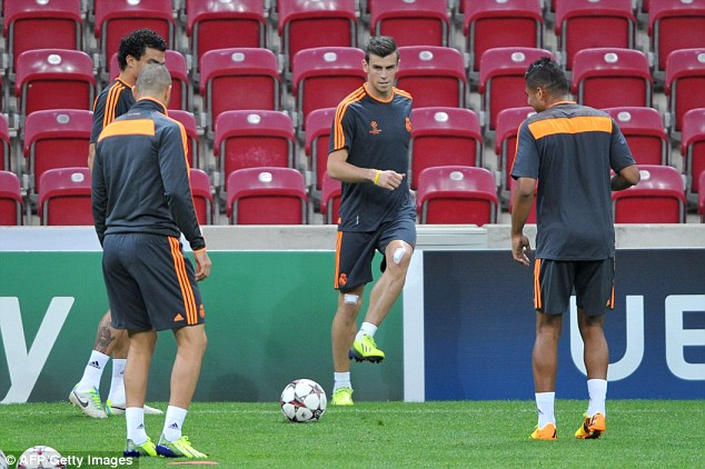 Settling in: Bale passes the ball amongst his teammates