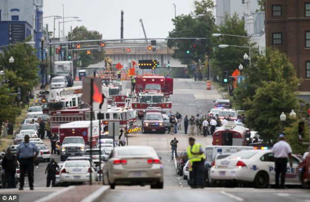 Chaos: Witnesses have described their terror after a shooting at the Washington Navy Yard on Monday, Pictured, emergency personnel respond to the scene in Washington D.C.