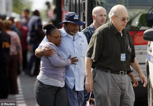 Reunited: Navy Yard workers are reunited with loved ones at the makeshift Red Cross shelter