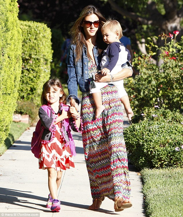 Rainbow bright: Alessandra Ambrosio wore a zigzag striped maxi dress that matched her daughter Anja's frock during a school run in Los Angeles on Monday