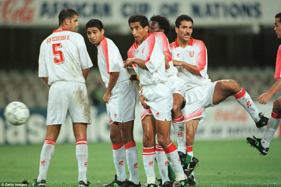 28 Jan 1996:  Tunisia's players Kodhbane Kaies and Badra Khaled defend a free kick at the quarter final of the African Cup of Nations at the Kings Park stadium in Durban. Tunisia won the game  by Four goals to Two after extra time and penalties.