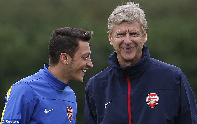 Joking around: New signing Mesut Ozil is also set to make his second start for the club