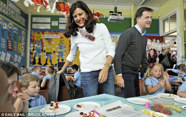 Visit: Mr Clegg was joined by wife Miriam on meeting children at Lairdlands Primary School, in Kirkintilloch near Glasgow