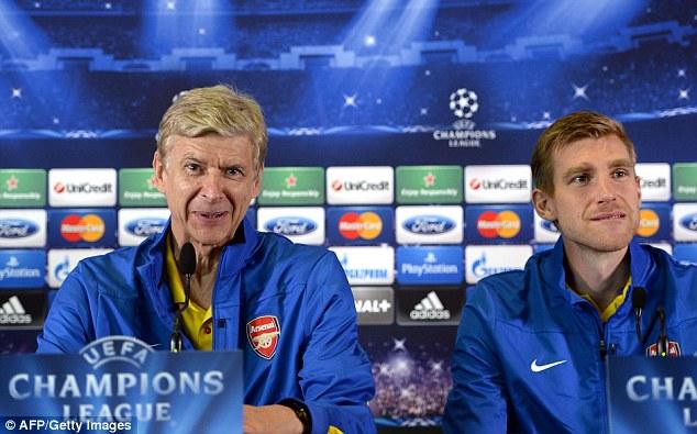 Confident: Arsene Wenger (left) and Per Mertesacker spoke at the pre-match press conference in Marseille