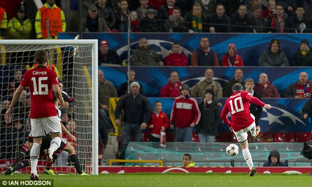 Opener: Rooney applies the finish to make it 1-0 to United against Leverkusen