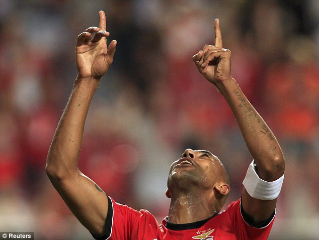 Looking above: Benfica's Luisao points to the sky after scoring against Anderlecht