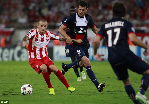 On target: Former Manchester City and Rangers player Weiss (left) scored for Olympiakos