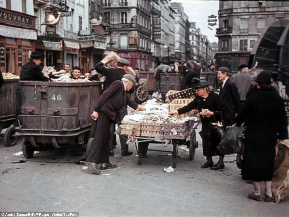 Getting what they can: Poorer looking Parisians at a down-at-heel street market