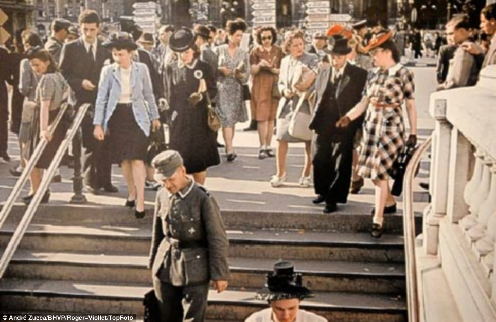 Propaganda: Historians say images such as this one of a Nazi solider (on steps) walking freely with Parisians