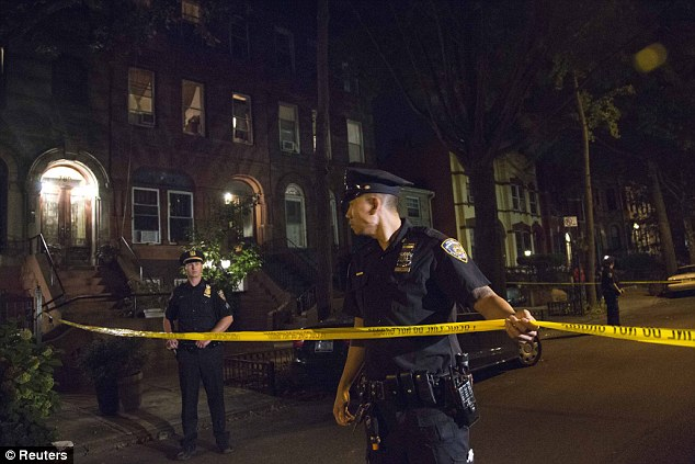 Policemen string police tape outside the Brooklyn residence Cathleen Alexis, mother of suspected Washington Navy Yard shooter Aaron Alexis, in New York September 16, 2013